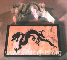 Dragons cut from Black Granite, Bullet-proof glass, and Marble.