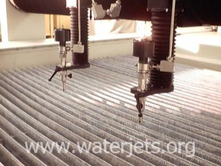 Dual waterjet nozzles