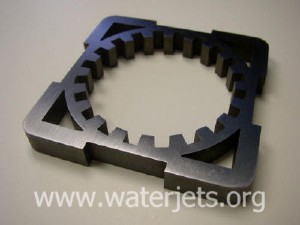 "Picture of interlock piece cut via abrasive waterjet in 0.4"" steel"