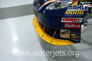 polycarbonate splitter cut by waterjet installed on race car