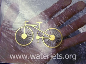 Metal bicycle glass inlay created by waterjet
