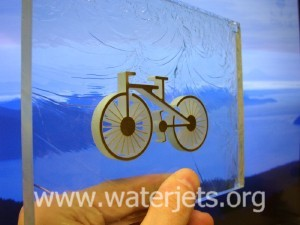 Metal bicycle in glass inlay created by waterjet