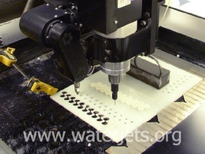 Waterjet with tilting head and mechanical drill accessory.