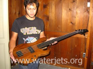 waterjet cut guitar made from wood