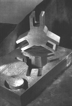 [picture of 2in ss304 machined with an abrasive waterjet]